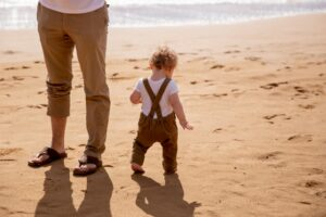 baby walking on the beach